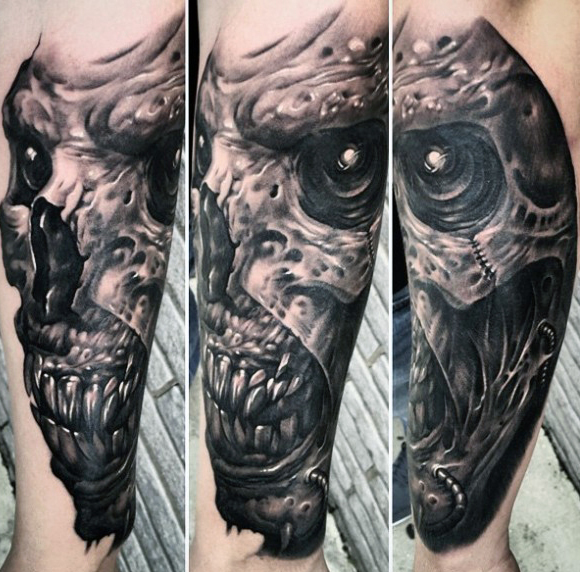 Grey Ink Most Scary Demon Face Tattoo On Lower Sleeve