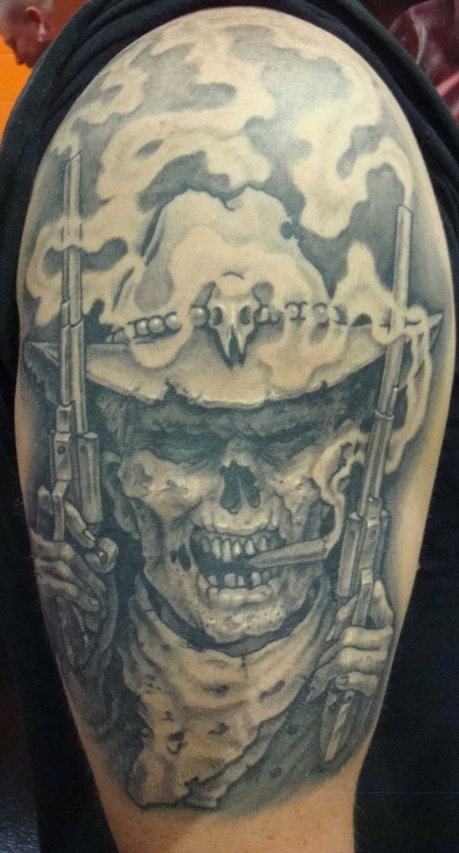 Grey Ink Scary Cowboy Skull And Gun Tattoo On Men Shoulder