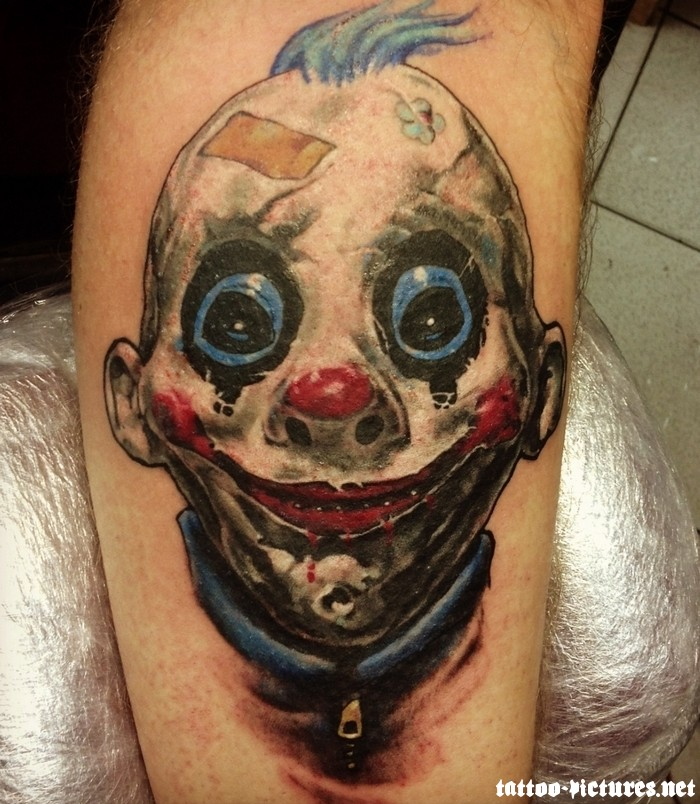 Horrible Scary Clown Face Tattoo On Men Leg