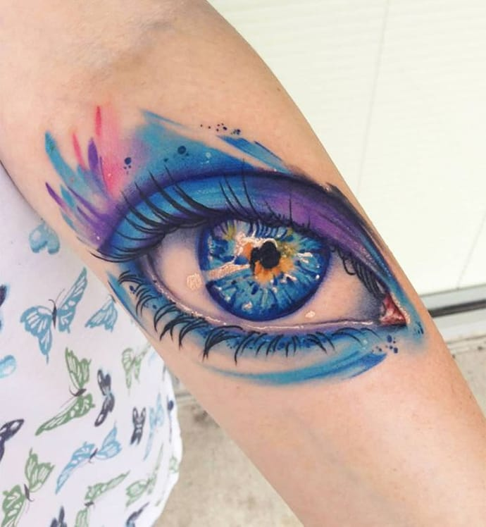 Impressive Aqua Eye Tattoo Design On Girl Sleeve
