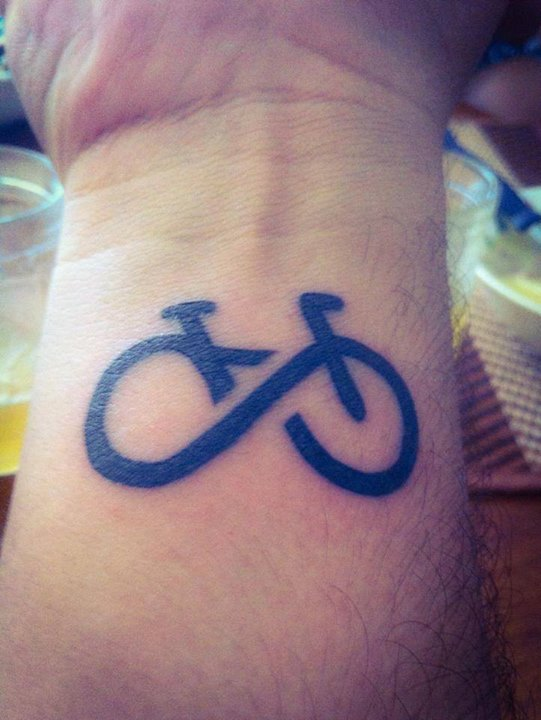 Impressive Black Ink Infinity Bike Tattoo On Wrist