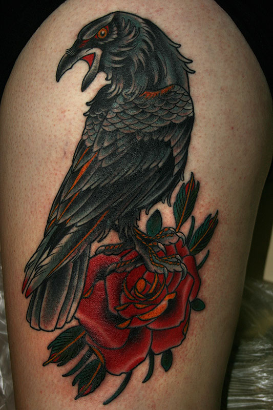Lovely Red Rose And Crow Tattoo Design On Thigh