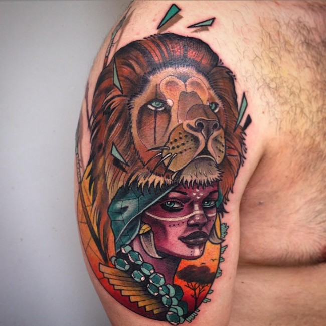 Old African Lady And Lion Mask Tattoo For Men Shoulder