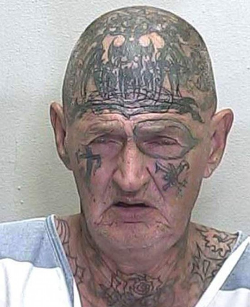 Old Man With Tribal Face And Head Tattoos