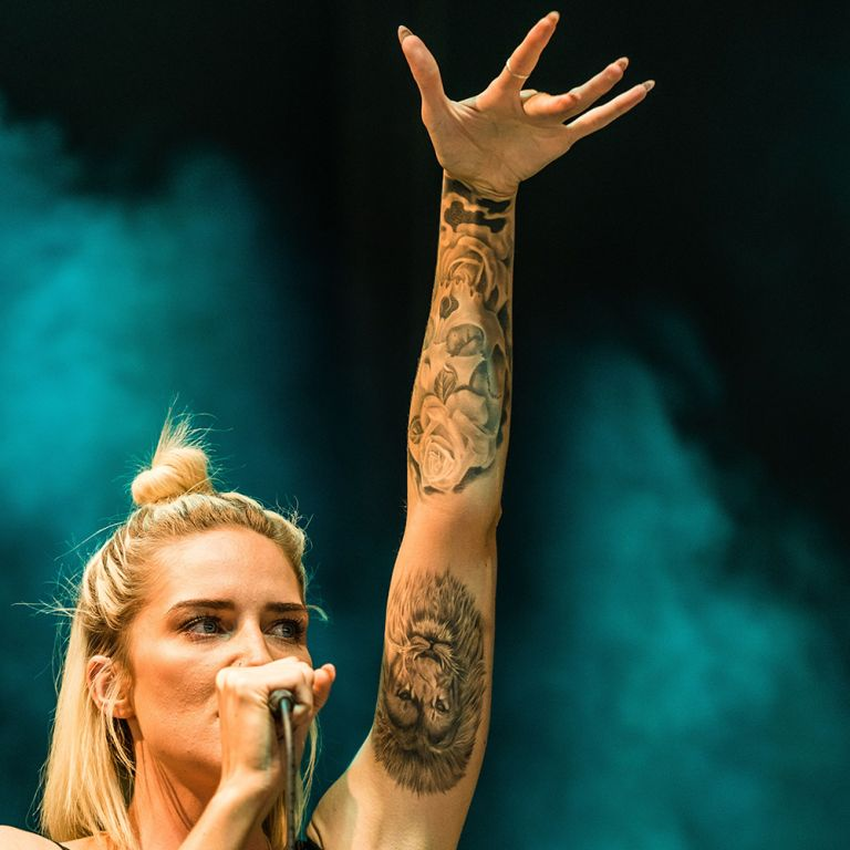 Pop Singer Celebrity With 3D Lion Head Tattoo On Inner Arm