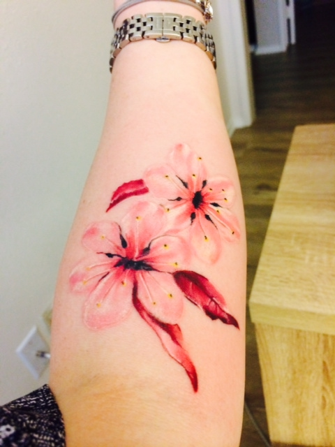 Red And Pink Ink Lovely Cherry Blossom Tattoo On Forearm