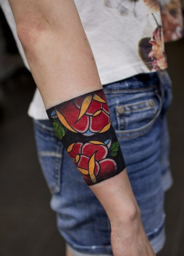 Red Flower In Solid Arm Band Tattoo On Girl Arm