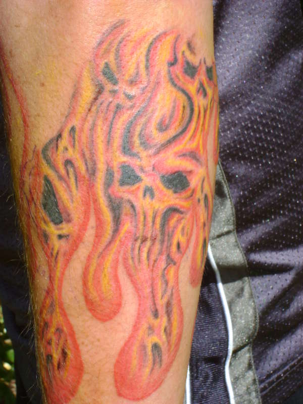 Red Ink Fire n Flame Skull Tattoo On Men Forearm