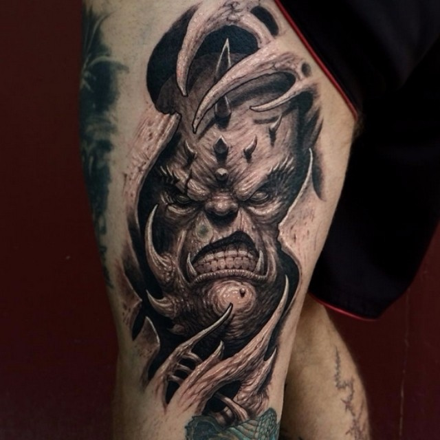 Scary 3d Demon Face Tattoo On Girl Thigh