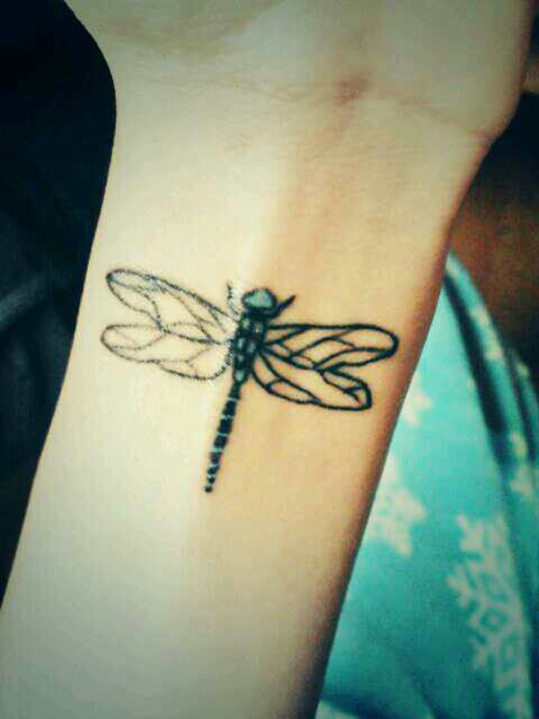 Simple Black Ink Dragonfly Tattoo On Girl Wrist