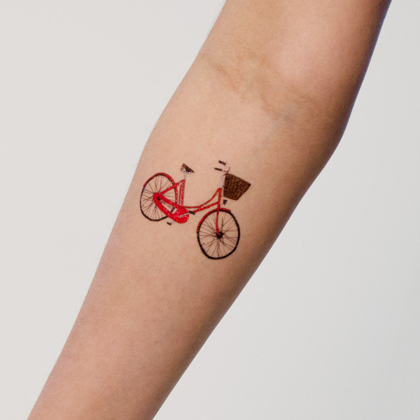 Small Red Bike Tattoo Made On Girl Sleeve