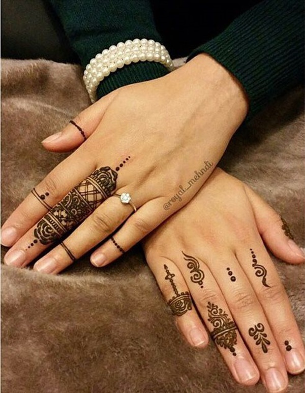 Traditional Heena Tattoo Art On Girl Fingers