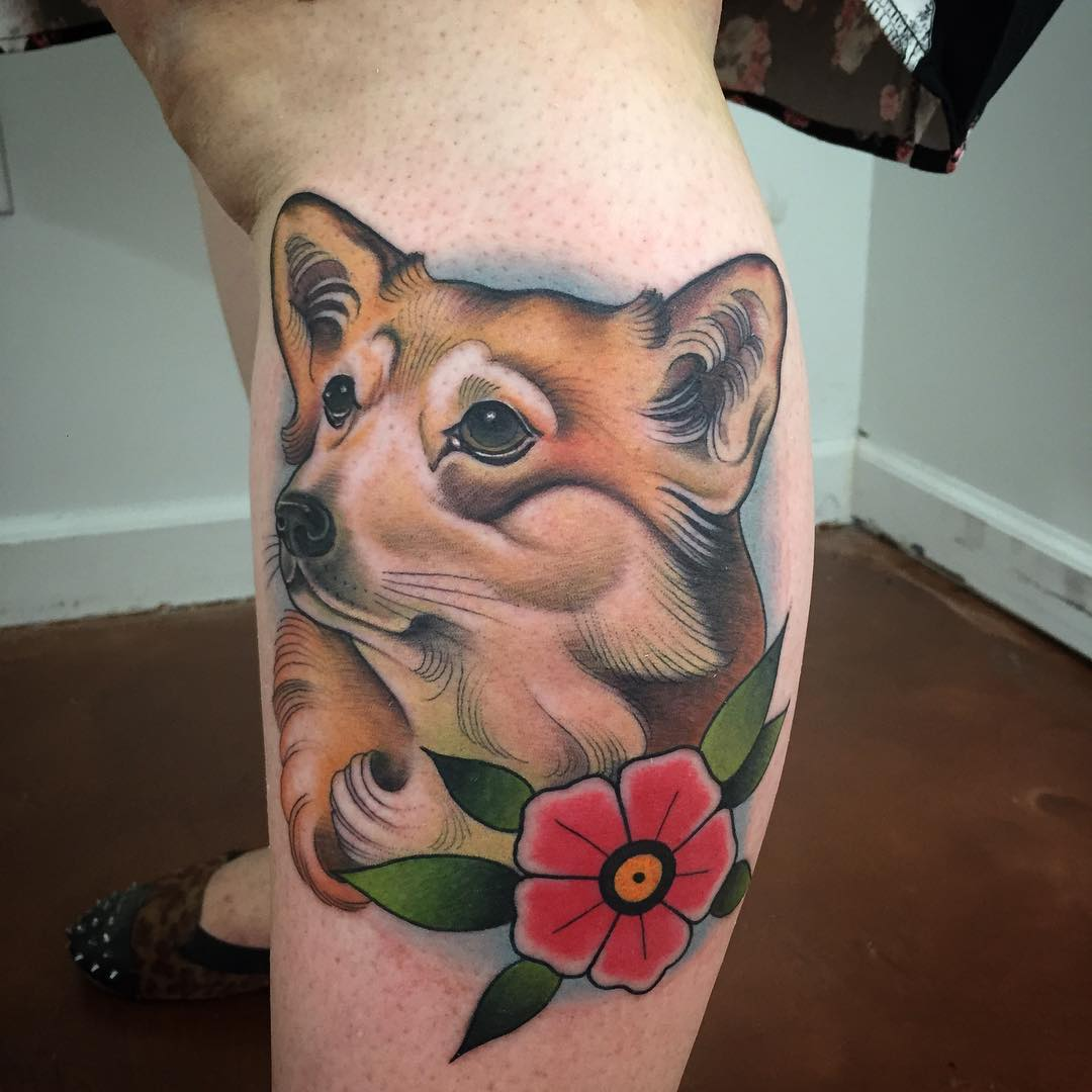 True Animated Dog  And Red Flower Tattoo On Thigh