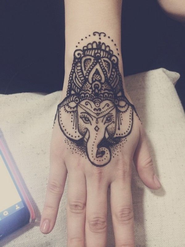 Amazing Dotwork Ganesh Face Tattoo On Girl Hand