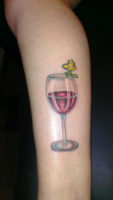 Amazing Red Wine In Glass Tattoo On Side Leg