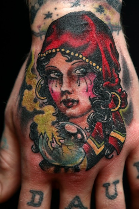 Attractive Traditional Gypsy Girl Face Tattoo On Men Hand