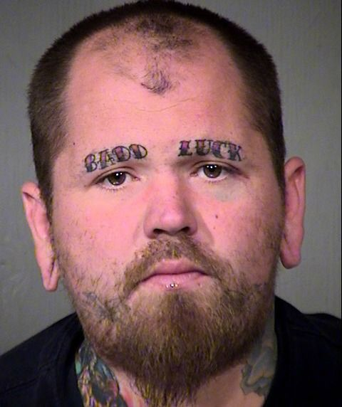 Badd Luck Forehead Tattoo For Funky Man