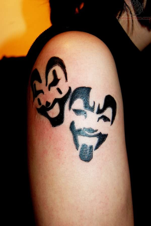 Black Ink Awesome ICP Face Mask Tattoo On Shoulder