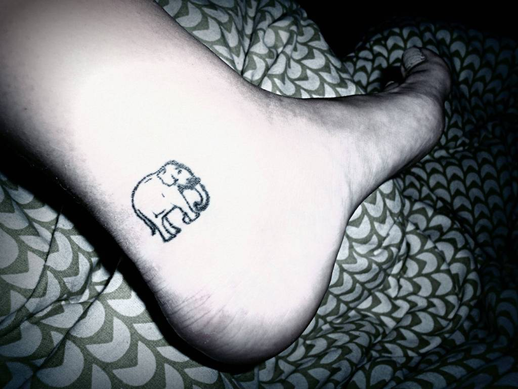 Black Ink Small Elephant Tattoo On Heel
