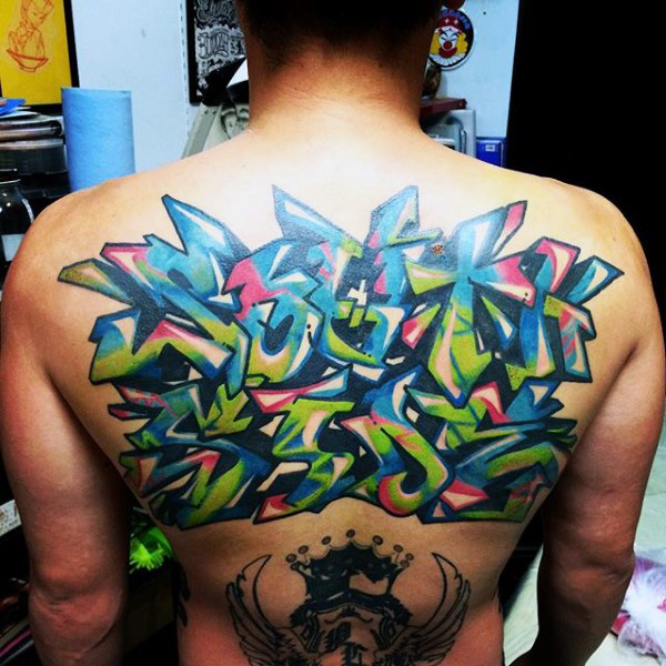 Colorful Amazing Graffiti Tattoo Design On Women Back