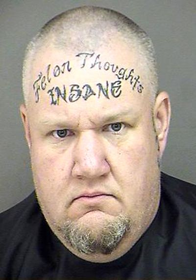 Famous Quote Tattoo Design On Men Forehead