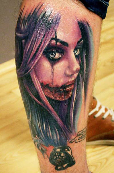 Fantastic Horror Girl Face Tattoo Design On Leg