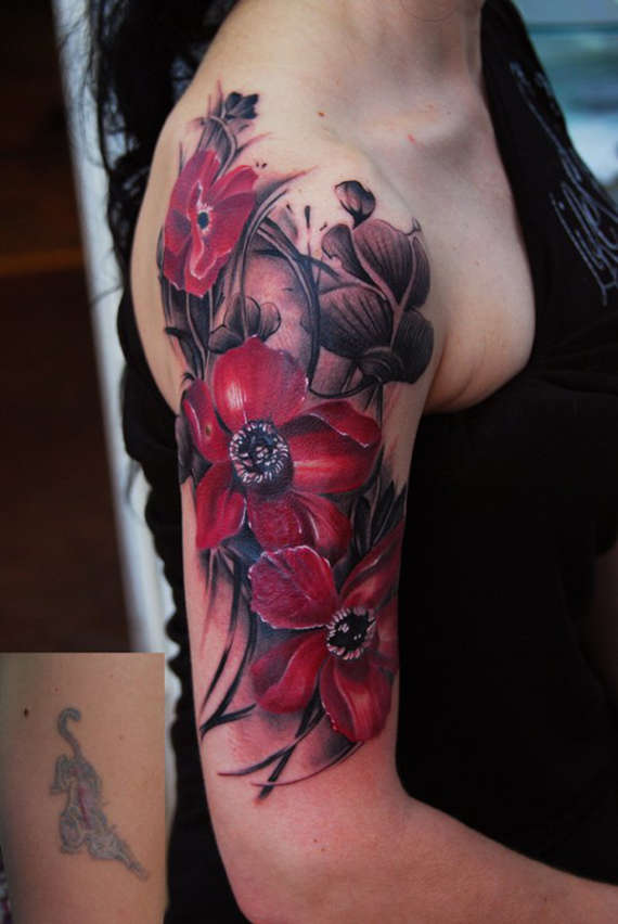 Fantastic Red Tribal Floral Tattoo On Girl Upper Sleeve