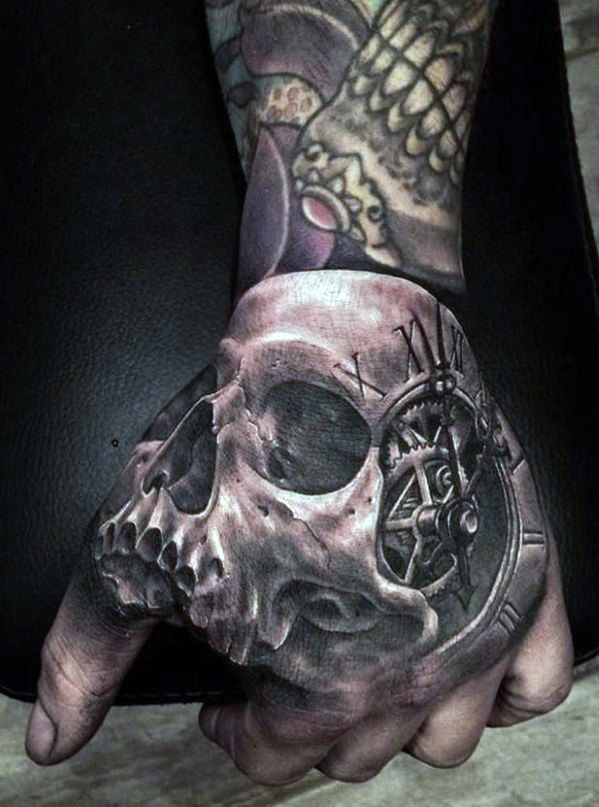 Grey Ink Fantastic 3d Skull Tattoo On Men Hand