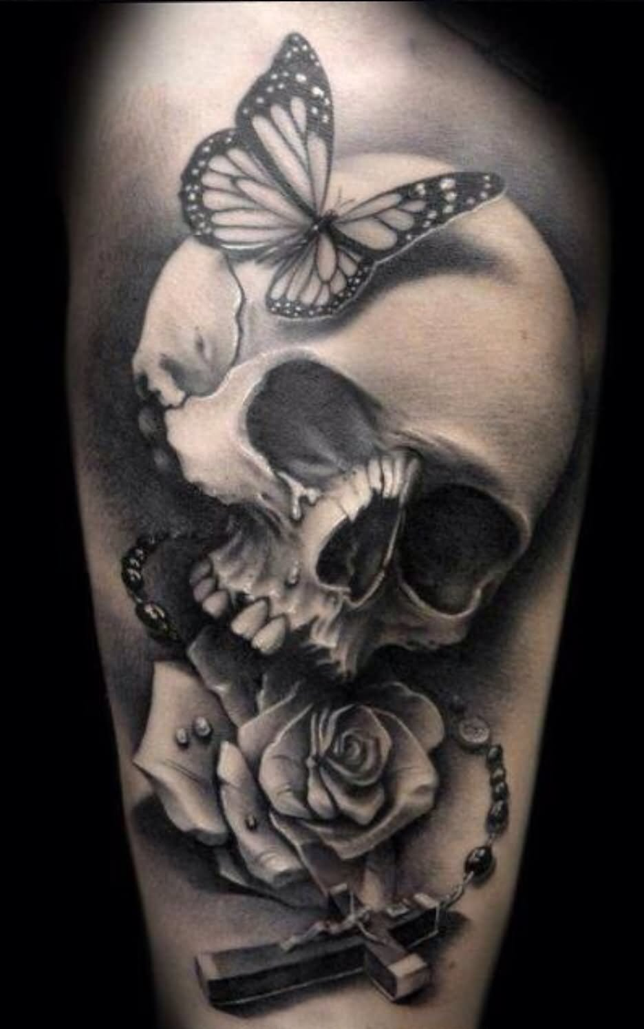 Grey Ink Gothic Skull Butterfly And Rose Tattoo On Thigh