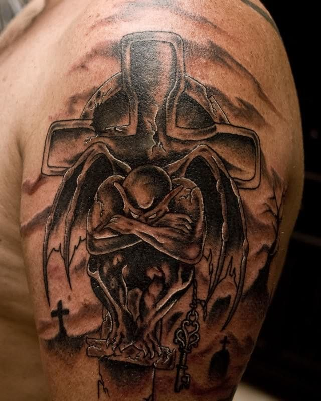 Grey Ink Holy Cross And Gargoyle Tattoo On Shoulder