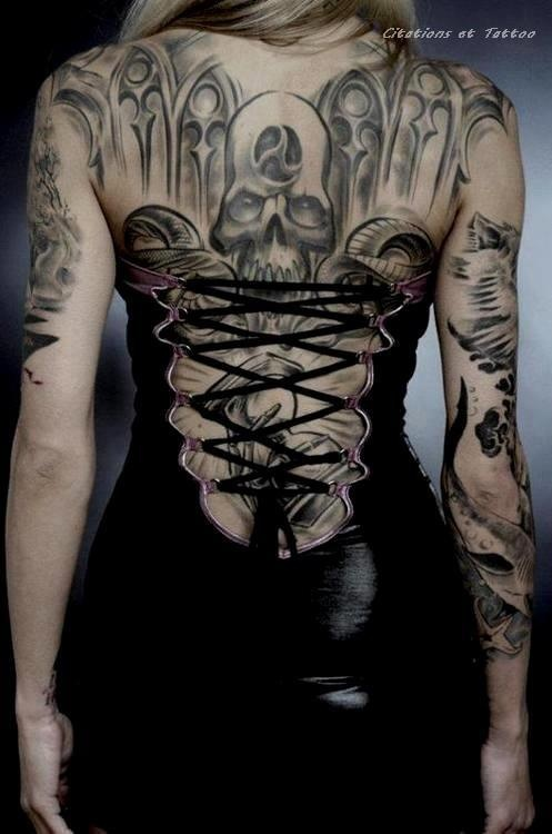 Grey Ink Scary Skull Gothic Tattoo On Girl Full Back