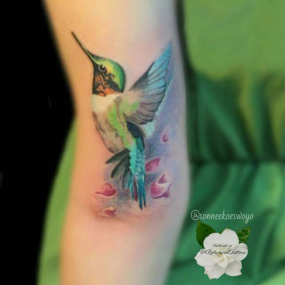 Nice Green Flying Hummingbird Tattoo Design On Arm