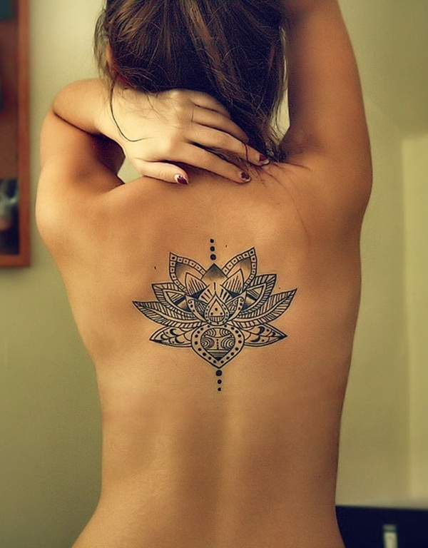 Outstanding Traditional Lotus Flower Tattoo On Girl Upper Back