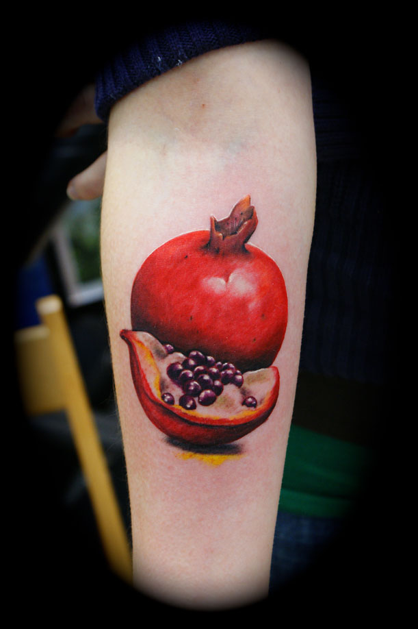 Red Ink 3d Pomegranate Tattoo On Girl Sleeve