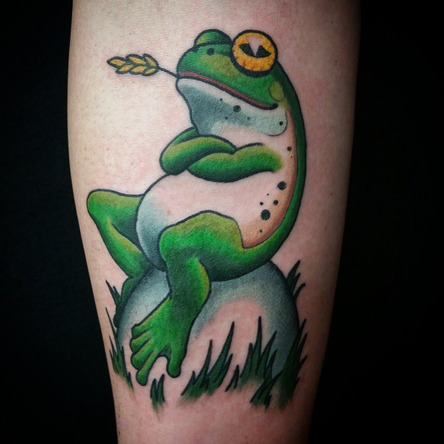 Relexed Animated Frog Tattoo On Forearm