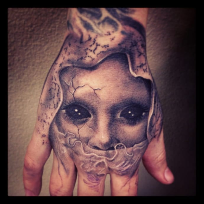 Scary 3d Face Tattoo On Men Hand