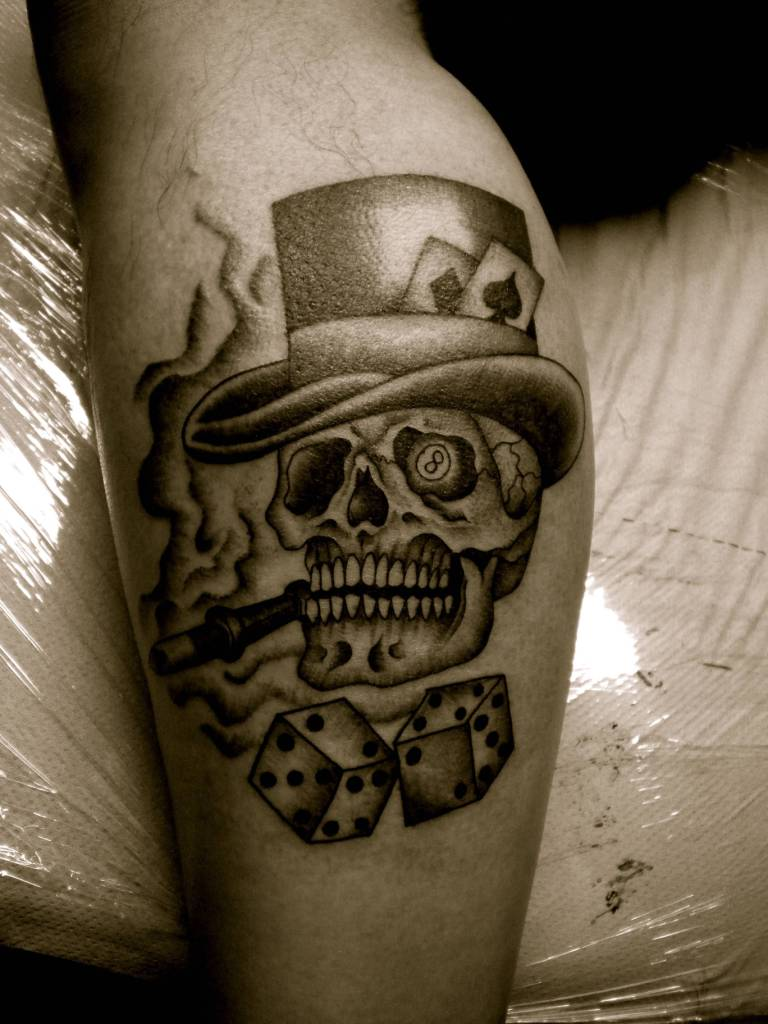 Scary Skull With Gambling Dice And Cards In Hat