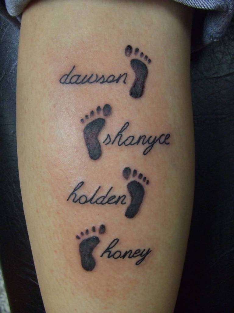 Small Little Footprints And Name Tattoo On Calf