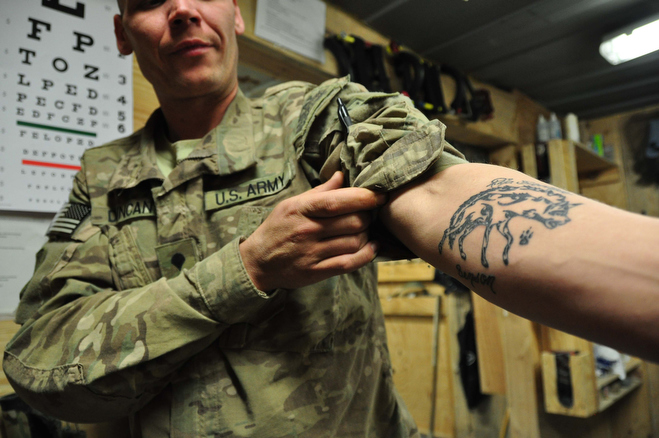 Spc Jason Duncan, medic, 36, Plymouth, IN, displays memorial tattoo for Spc Benson small file.jpg CAPTION: Spc. Jason Duncan, another medic, displays his memorial tattoo for Doc Benson. Doc Benson had a hyena head on his arm, and another tattoo on his chest that read, ÒWhy so serious?Ó CREDIT: Michael M. Phillips/The Wall Street Journal