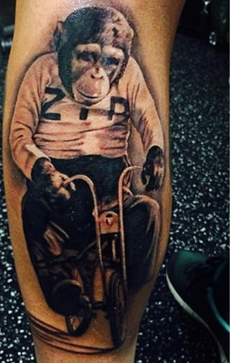 3d Passionate Monkey On Small Bicycle Bike Tattoo