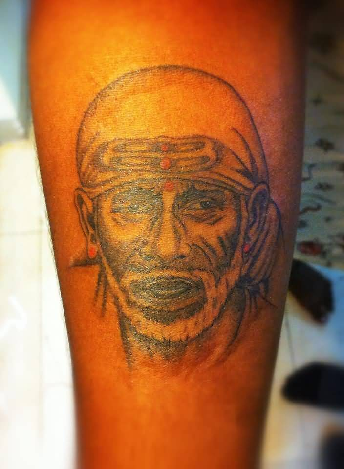 Amazing And Wonderful Sai Baba Face Tattoo Design
