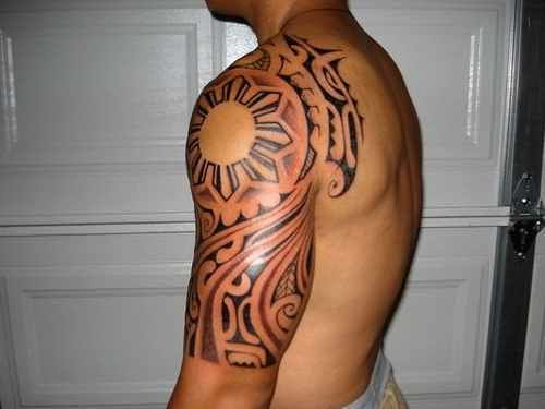 Amazing Half Sleeve Filipino Sun And Polynesian Tattoo For Men