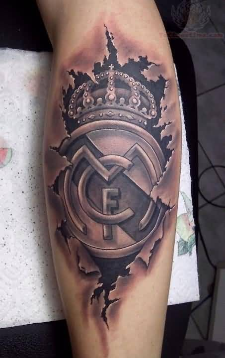 Amazing Simple Grey Ink Ripped Skin Real Madrid Logo Tattoo