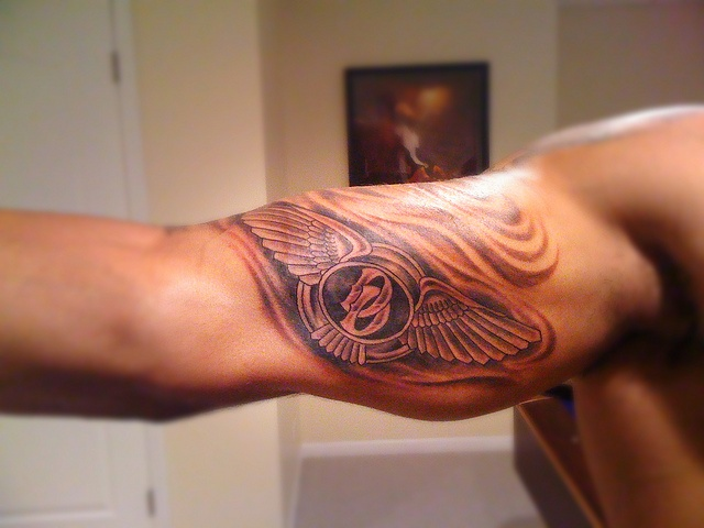 Angel Bustos Design A Amazing Bentley Text Tattoo