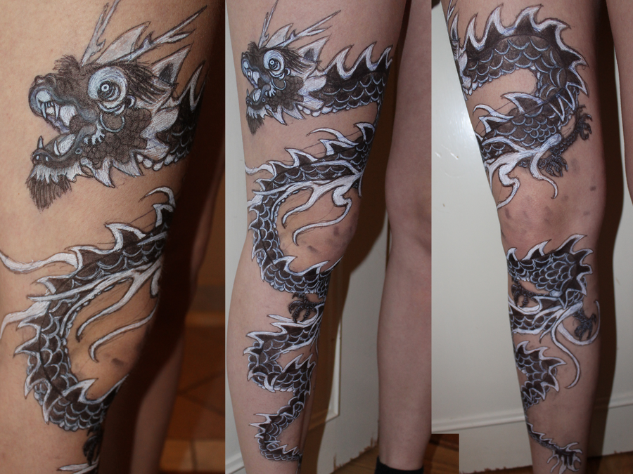 Angry Dragon Scarification Face Tattoo On Thigh