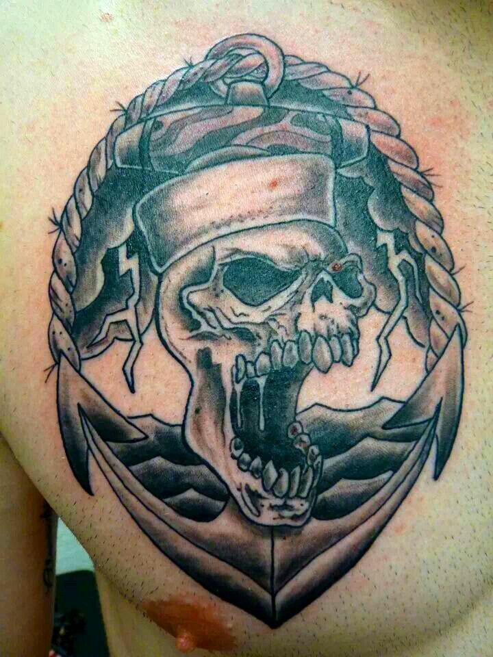 Angry Navy Skull With Anchor Men Chest Tattoo