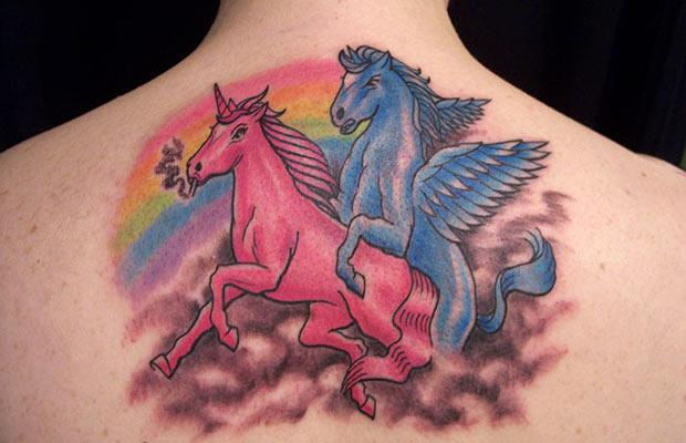 Angry Playboy Pegasus Tattoo Design On Upper Back