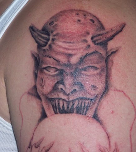 Angry Satan Scary Face Tattoo Design On Men Shoulder