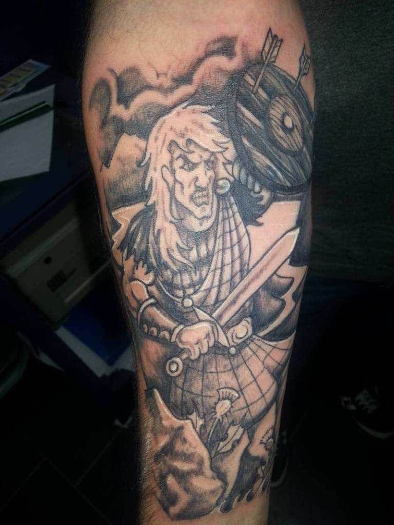 Angry Scottish Warrior Hold Shield And Sword Tattoo