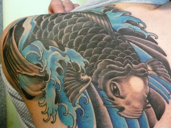 Angry Sea Creature Koi Fish Tattoo On Upper Back